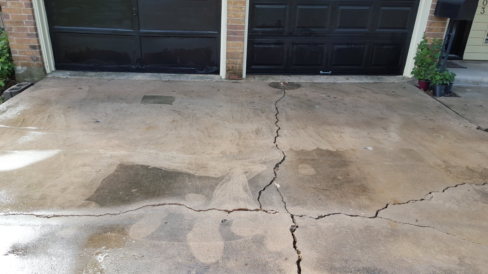 AFTER - The driveway was level and all voids filled.