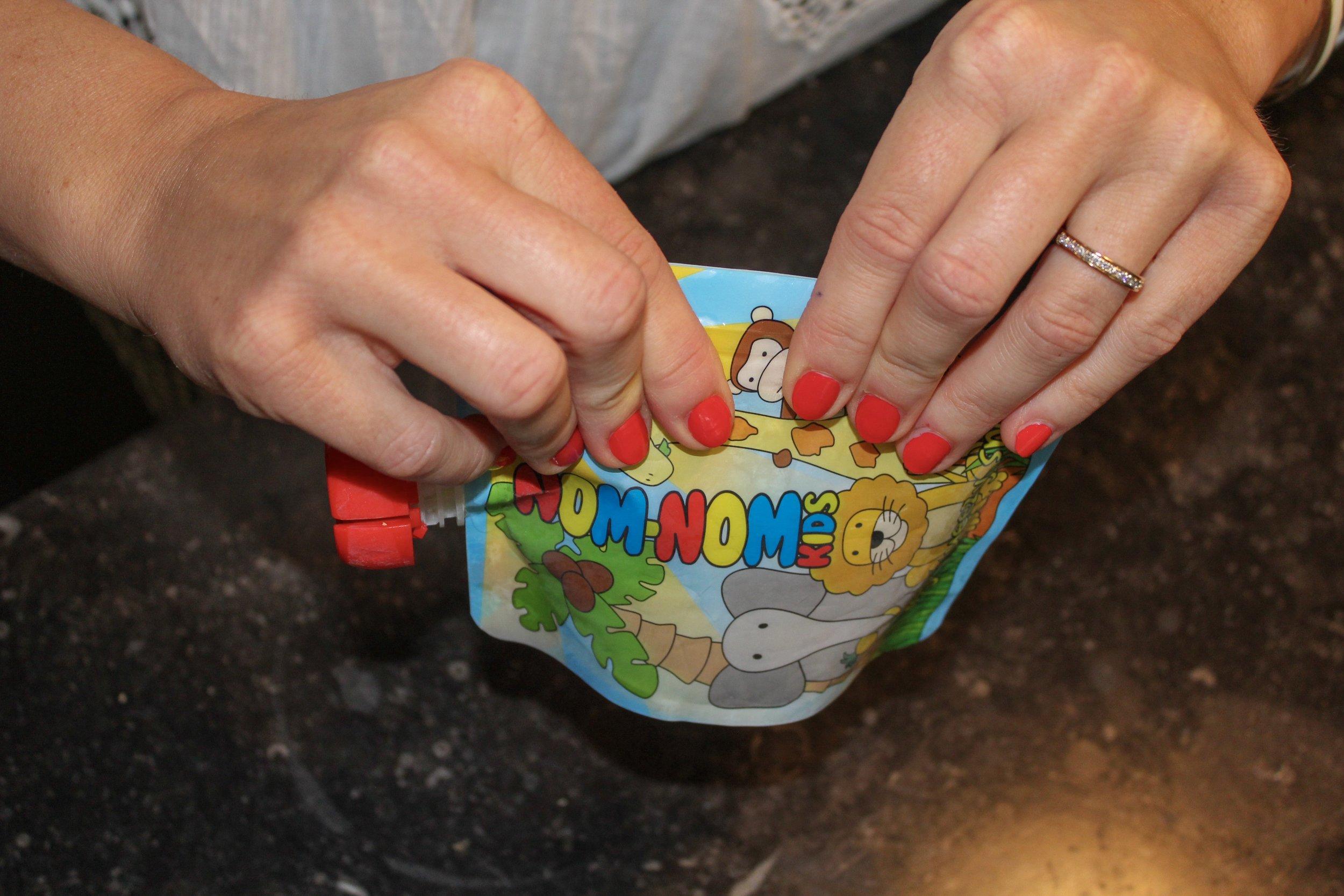 Nom Nom kids reusable food pouch with no-fail ziplock.