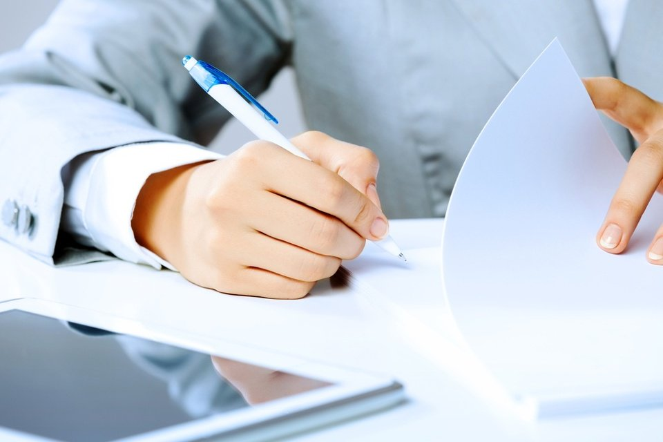 Close up image of businesswoman hands signing documents.jpeg