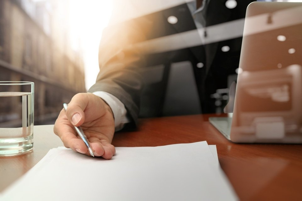double exposure of businessman or salesman handing over a contract on wooden desk.jpeg