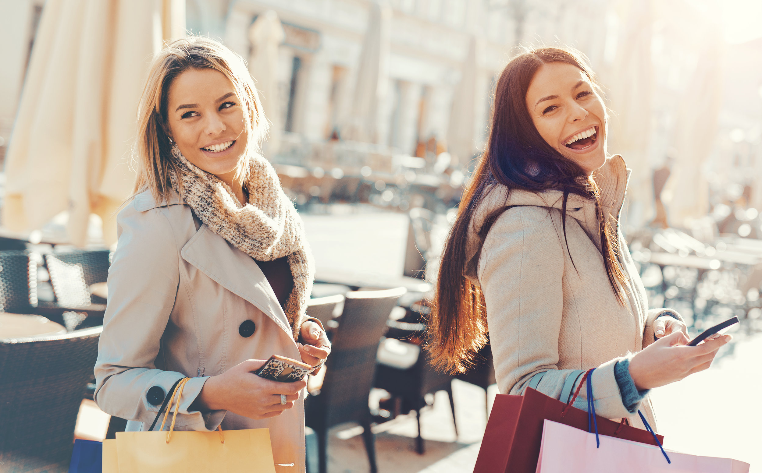two girls shopping and laughing