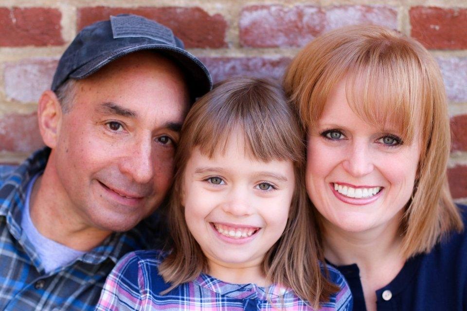 Kari with her husband, Matt, and daughter.