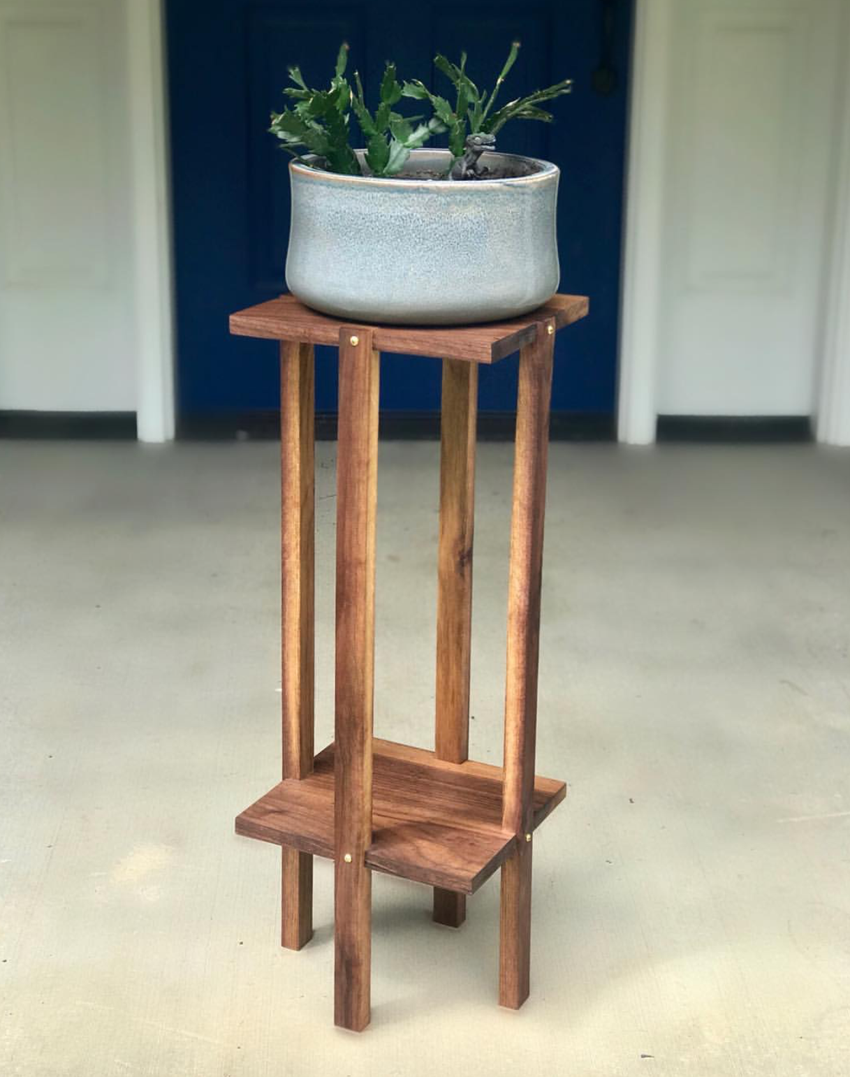 - This custom plant stand with is made of walnut and solid brass hardware. Check back soon for a link to purchase this beautiful plant stand for yourself!