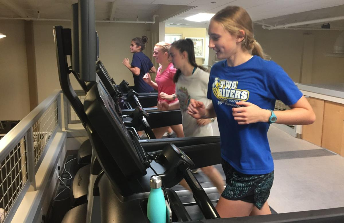 Working out at HealthQuest Fitness Center on Friday are Napa High cross country runners, foreground to rear, Molly McGrath, Jane McLoughlin, Emma Sarazin and Heidi Hirsohn.