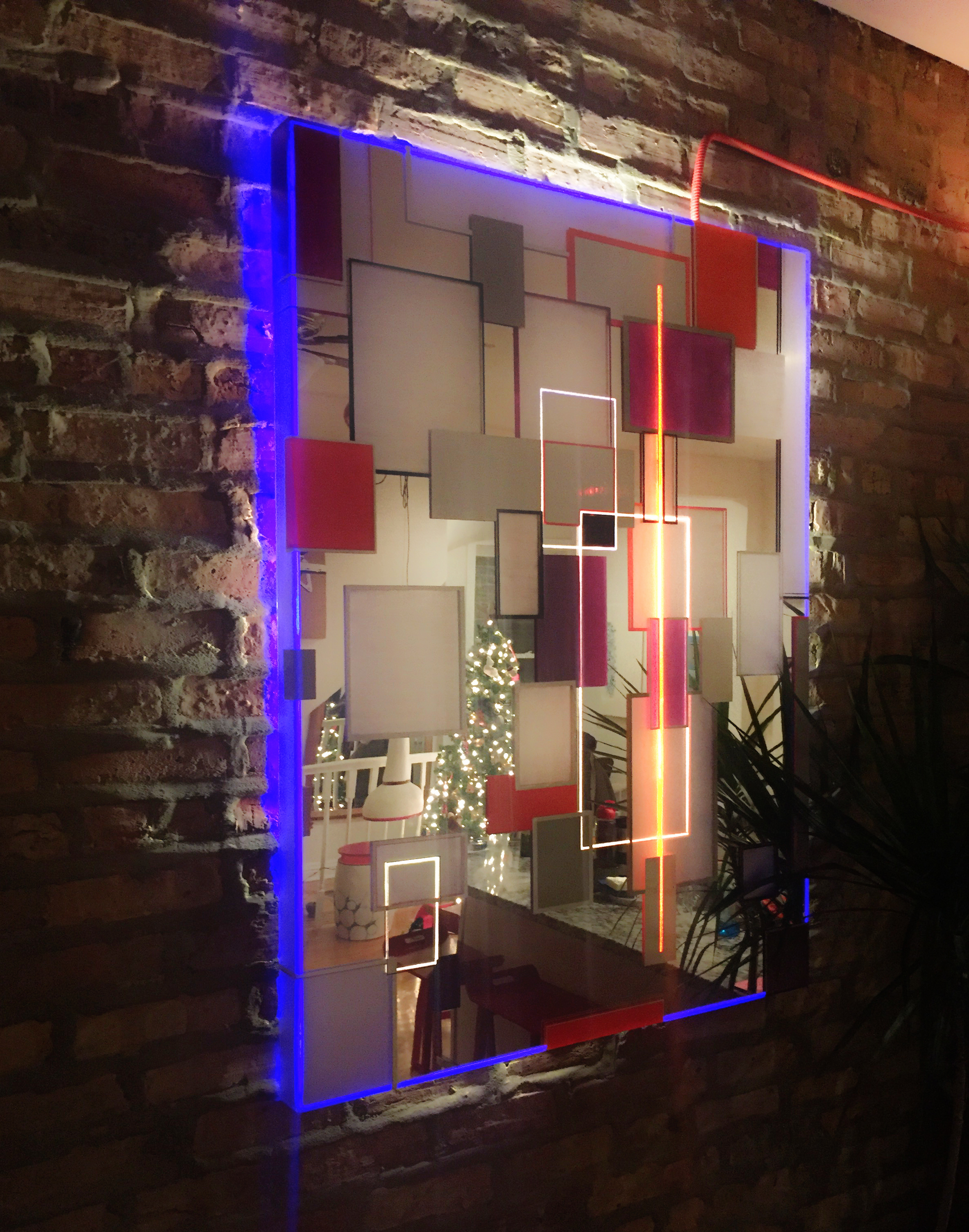 Light sculpture made of acrylic mirror, paint, LED, with blue and red colors entitled Beacon 7.