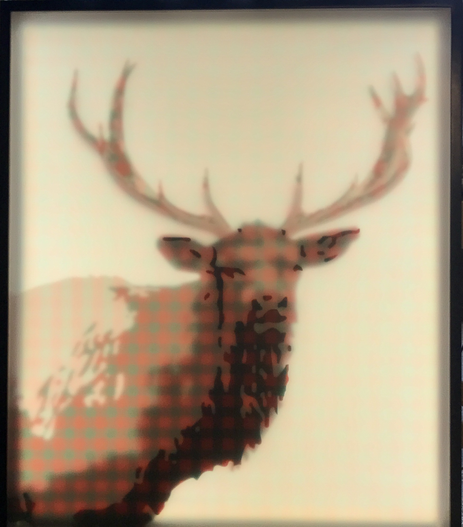 Printed plexiglass artwork of an elk with warm-toned moire pattern.
