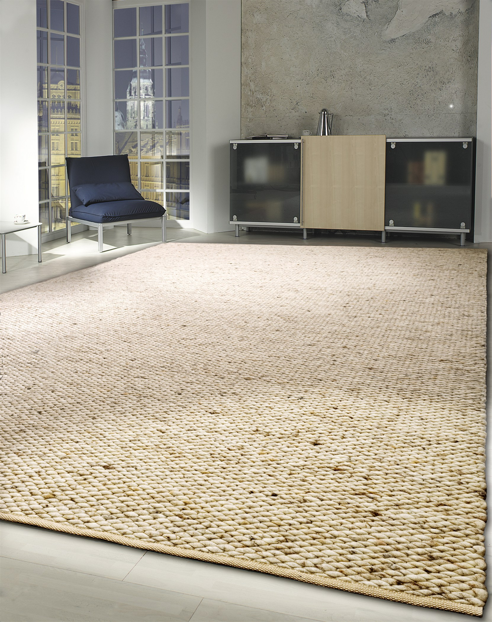 Modern, contemporary home with a light-brown rug woven with New Zealand Felted Wool.