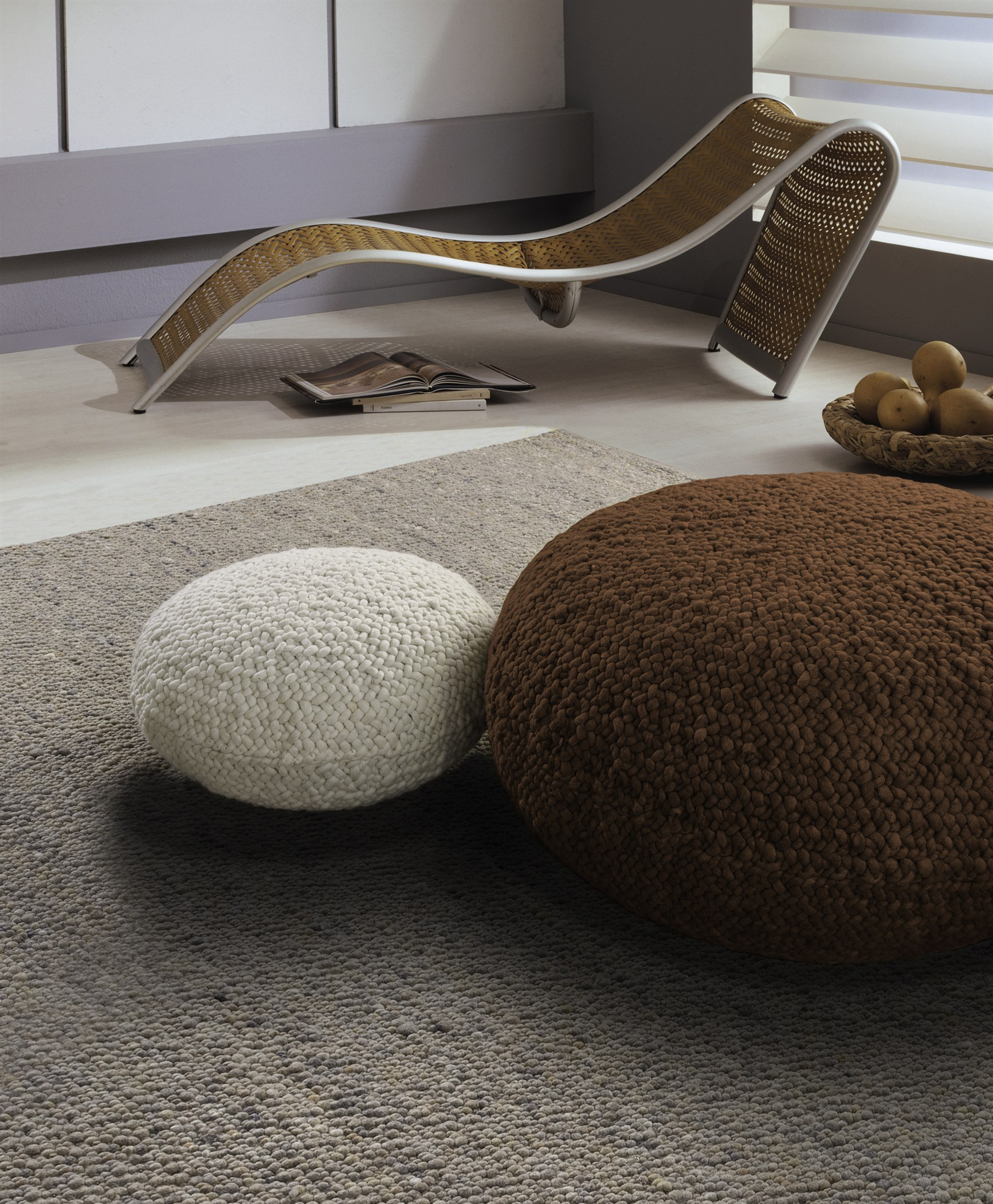 Modern, contemporary home with a medium-brown rug woven with New Zealand Felted Wool.