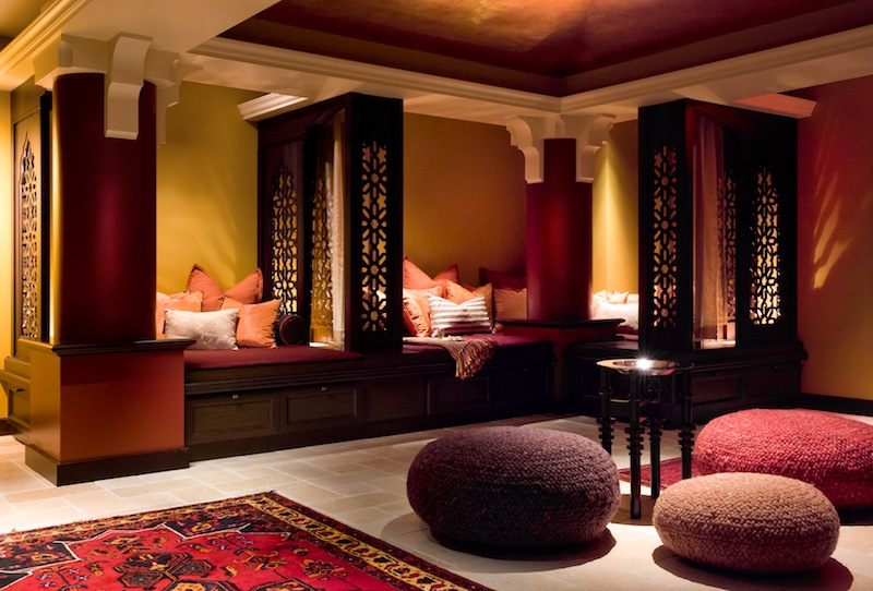 Modern, contemporary designed room with three poufs woven with felted wool in red.