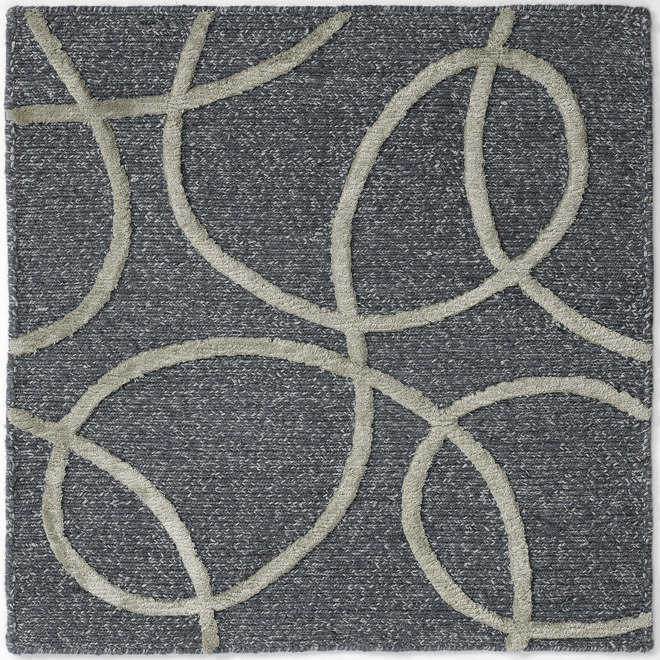 Hand-knotted, wool nettle silk rug with abstract design in blue green cream.