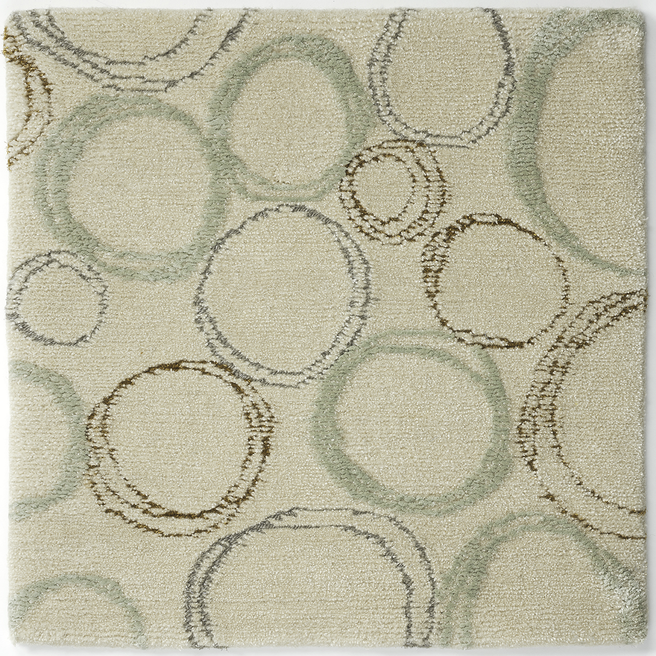 Hand-knotted, wool nettle silk rug with abstract design in green gold silver neutral cream.