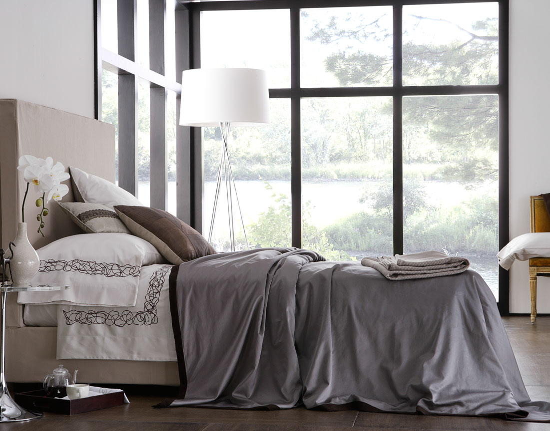 Modern designed home with sateen linens in off-white with black details.