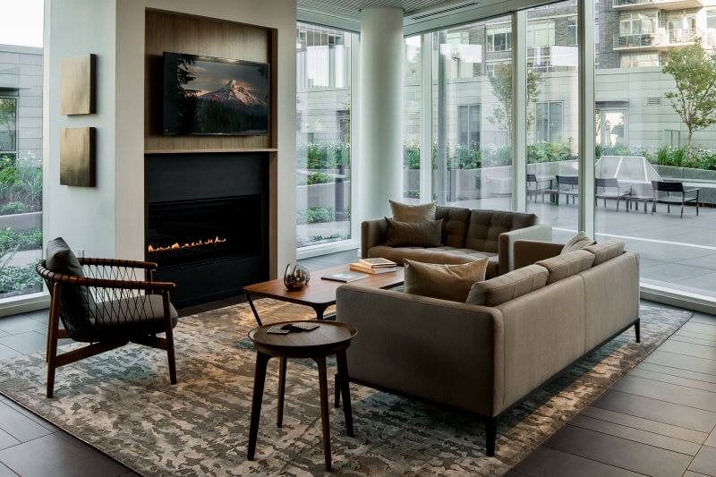 Modern, contemporary home with a custom distressed rug in neutral tones.