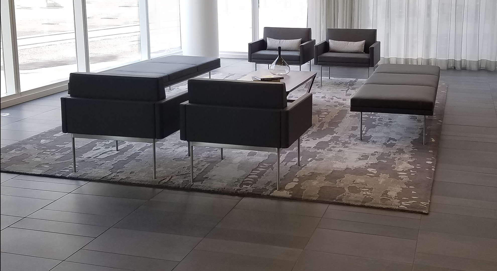 Modern, contemporary home with a custom distressed rug in neutral grays.