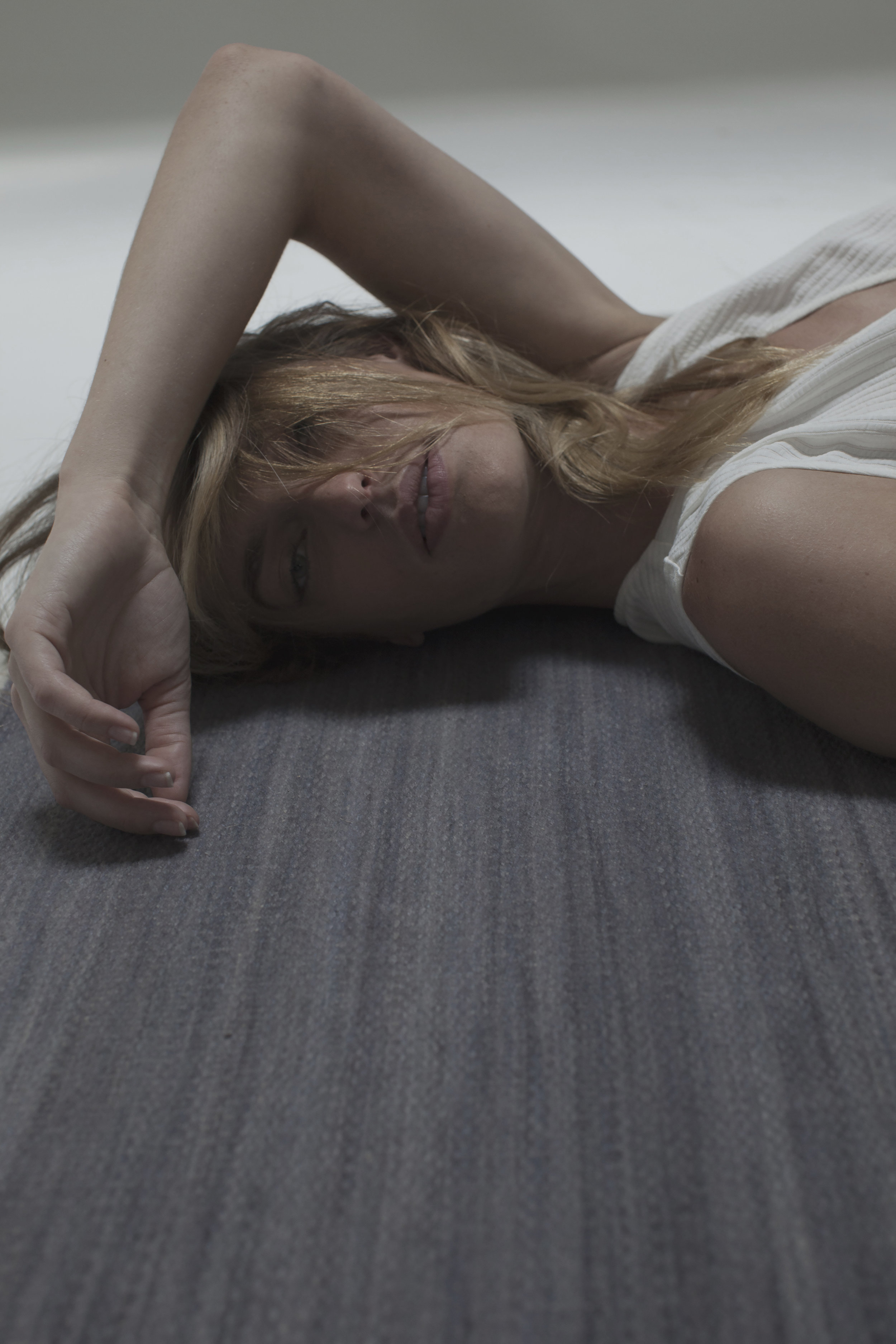 Girl laying on Ren Area Rug