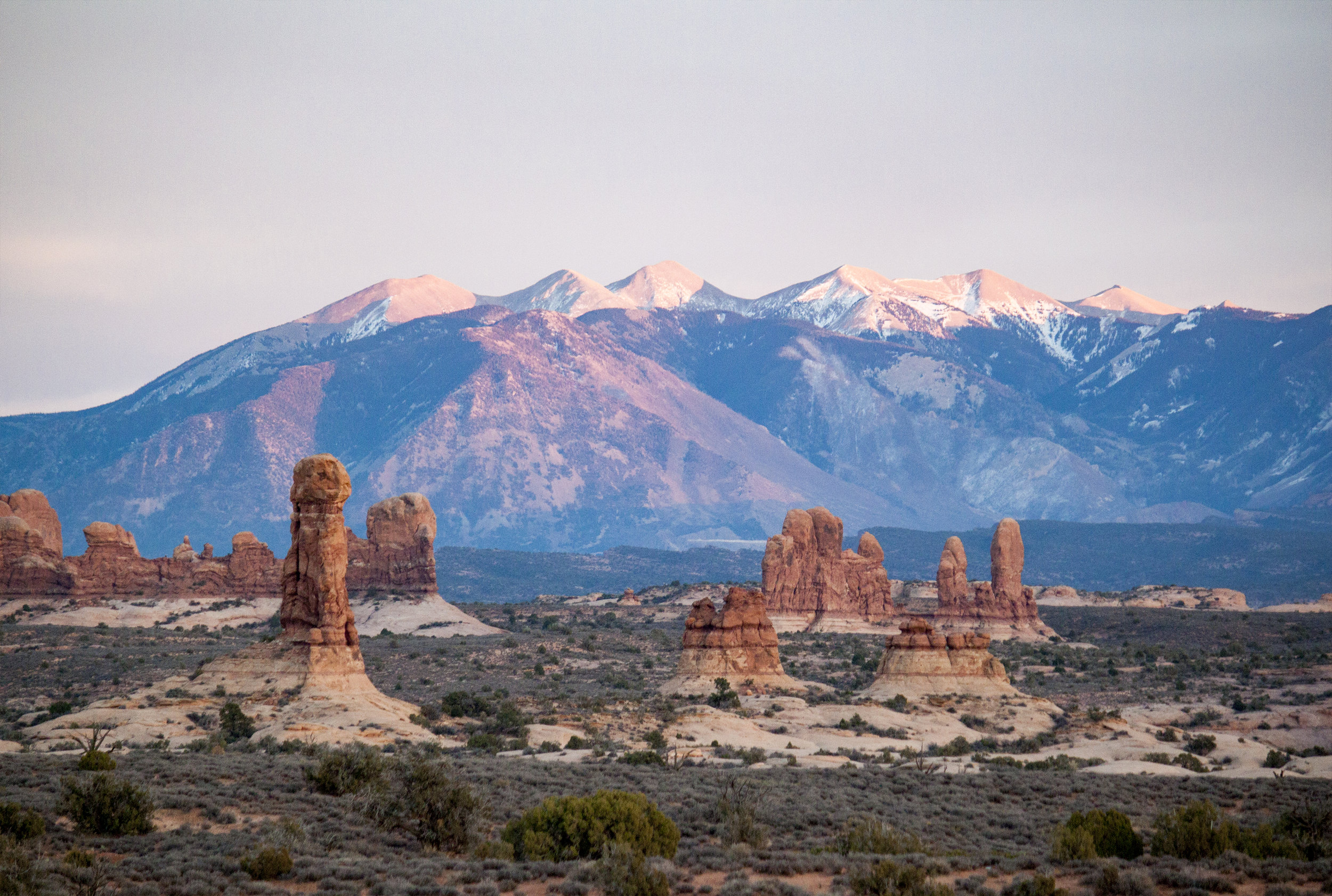 La Sal mountains behind arches in Arches National Park.  Photo by Alison Travis .