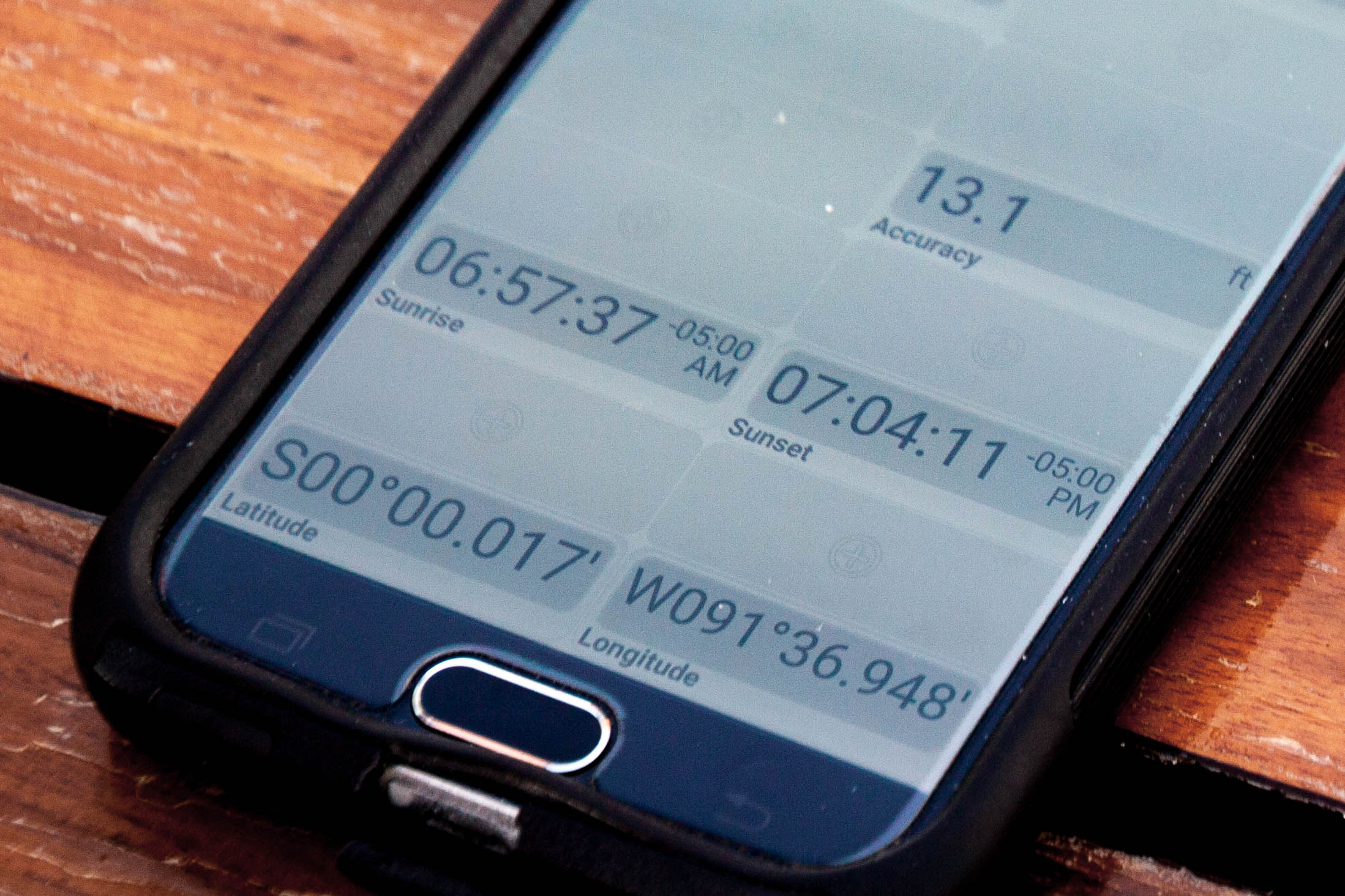 This phone shows our location on the globe using GPS.  Photo by Alison Travis