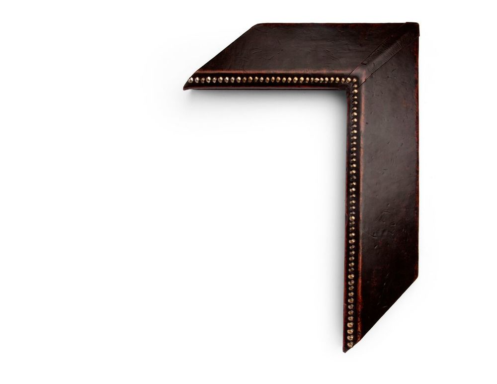 Reverse Slanted Copper A 4 inch leather-wrapped frame, with copper-colored metal studs all along the inside lip, and a reverse slanted face. The finish is a deep brown natural leather with distressing at the edges. There are many finishes and leathers to choose from, and no two are exactly alike.