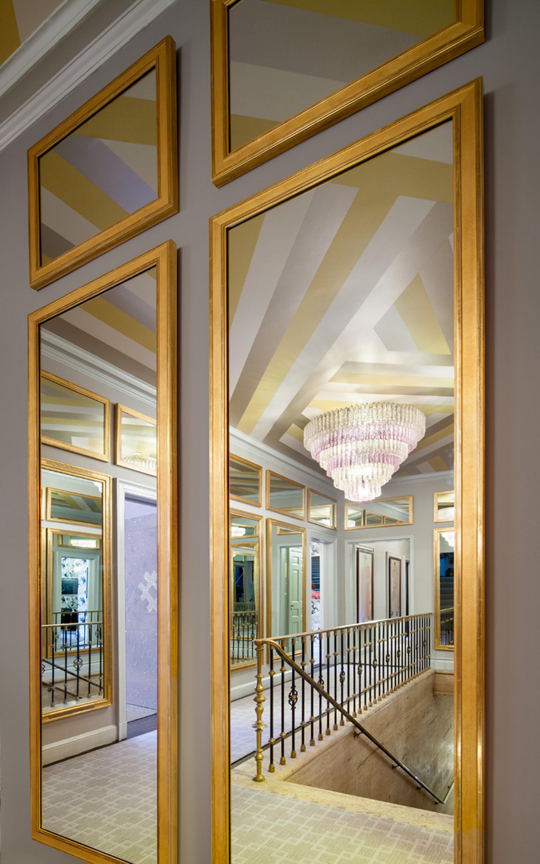 Rectangular gold framed mirrors hanging on wall