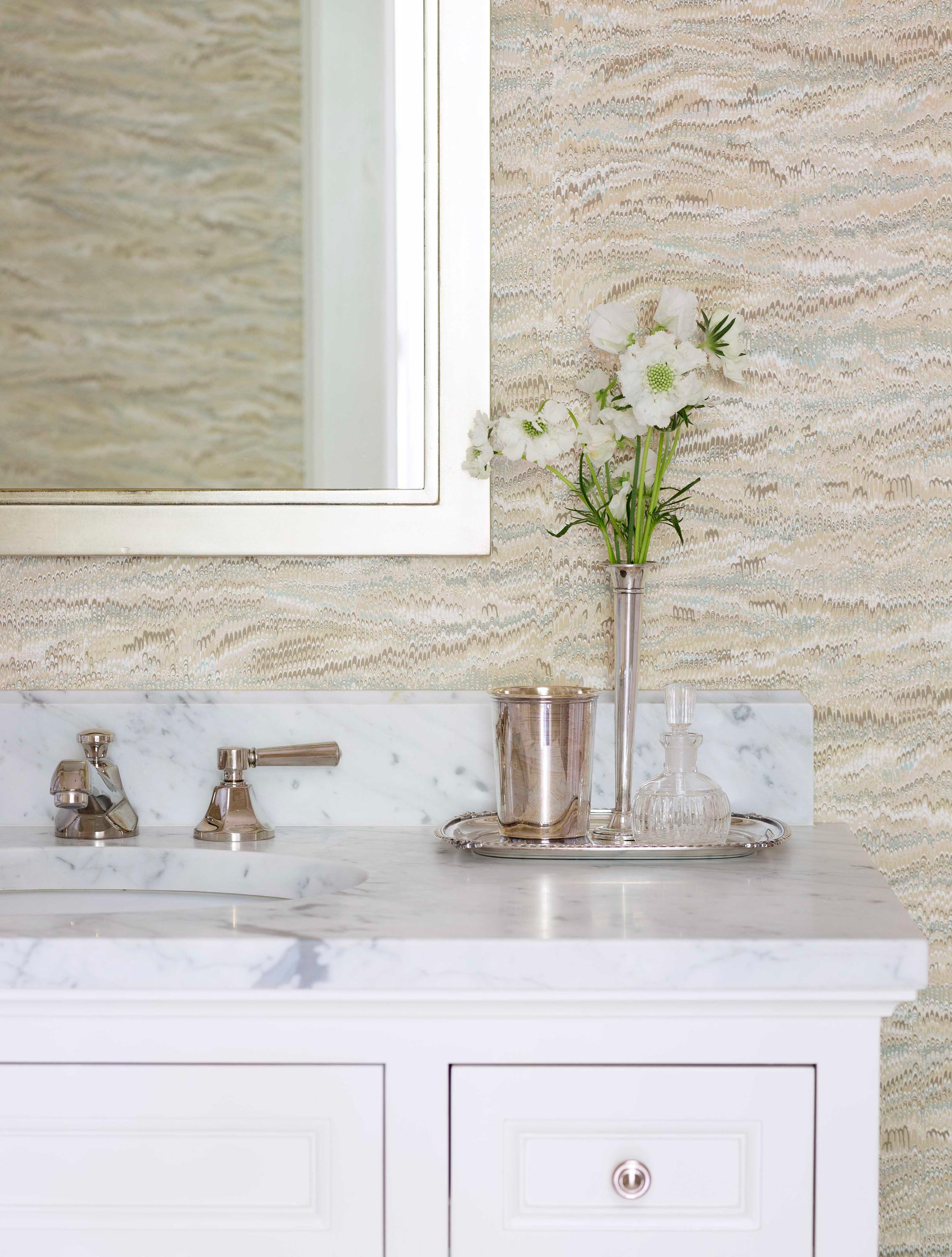 White framed mirror mounted above sink in bathroom