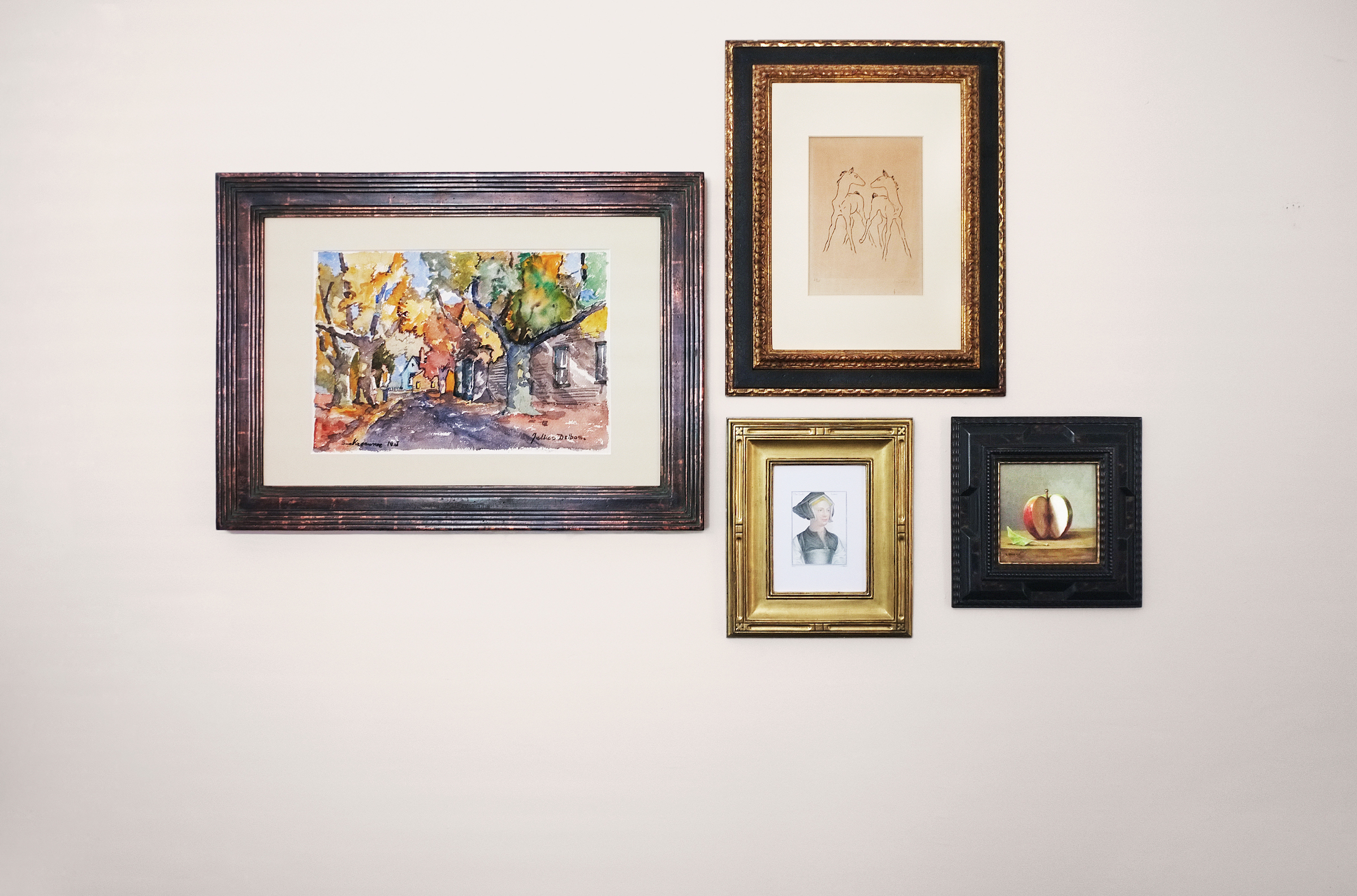 Four mounted picture frames with prints