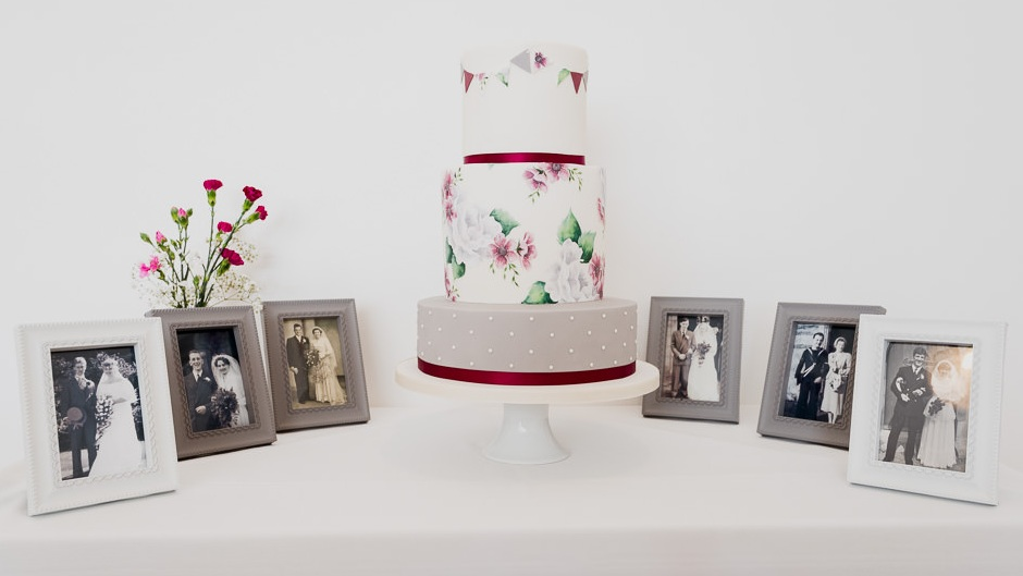 Hand painted wedding cake in burgundy and grey