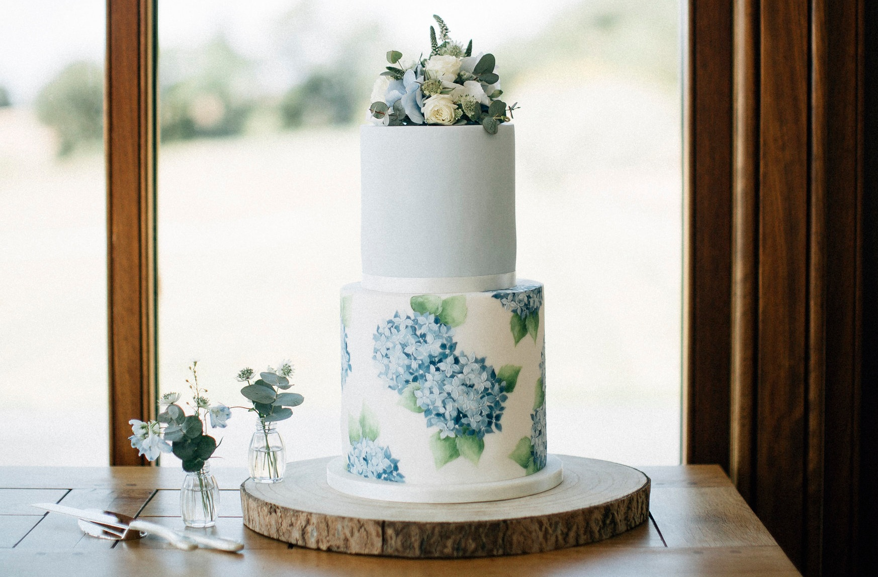 Hydrangea blue hand painted 2 tier wedding cake Emily Hankins