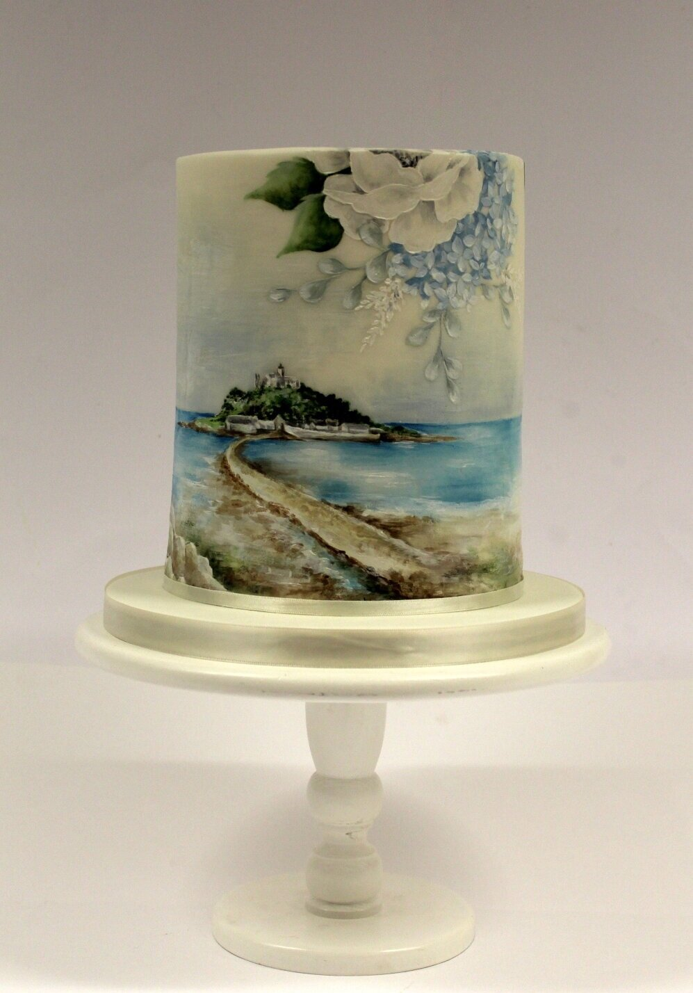 Full Cake - single tier cake with a hand painted (cocoa butter paint) landscape of St Micheals Mount in Cornwall and my signature flowers.JPG