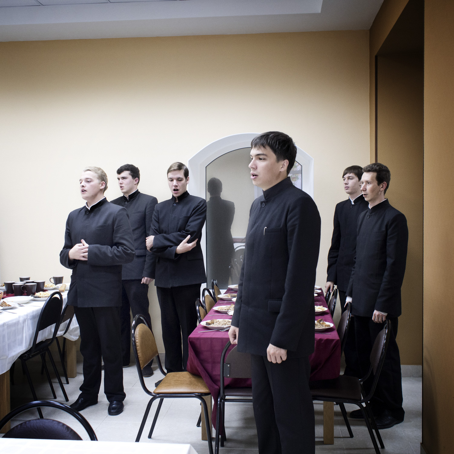 Priest students singing a prayer before lunch. When the seminary was in need of transport the local Muslim institute financed their minibus.