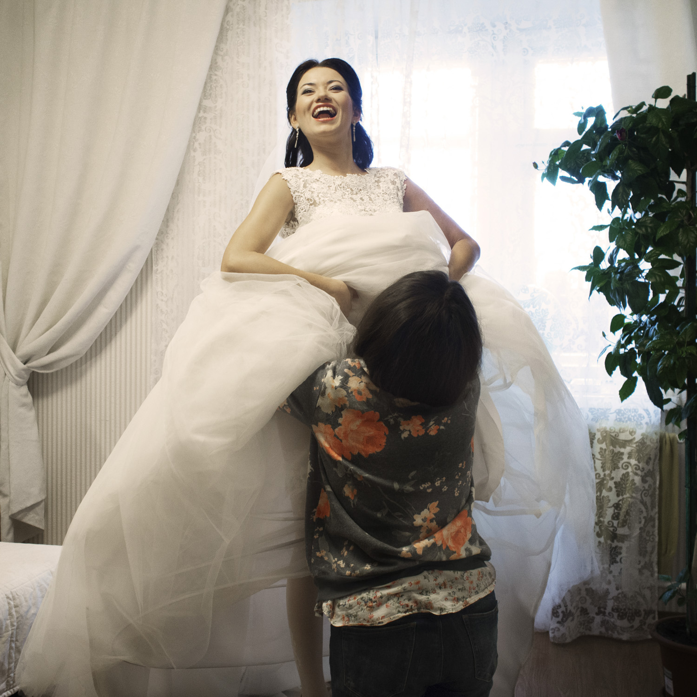 One third of all weddings in Kazan are interfaith ceremonies. Albina is Tatar Muslim and her groom Semjon Russian is Orthodox Christian.