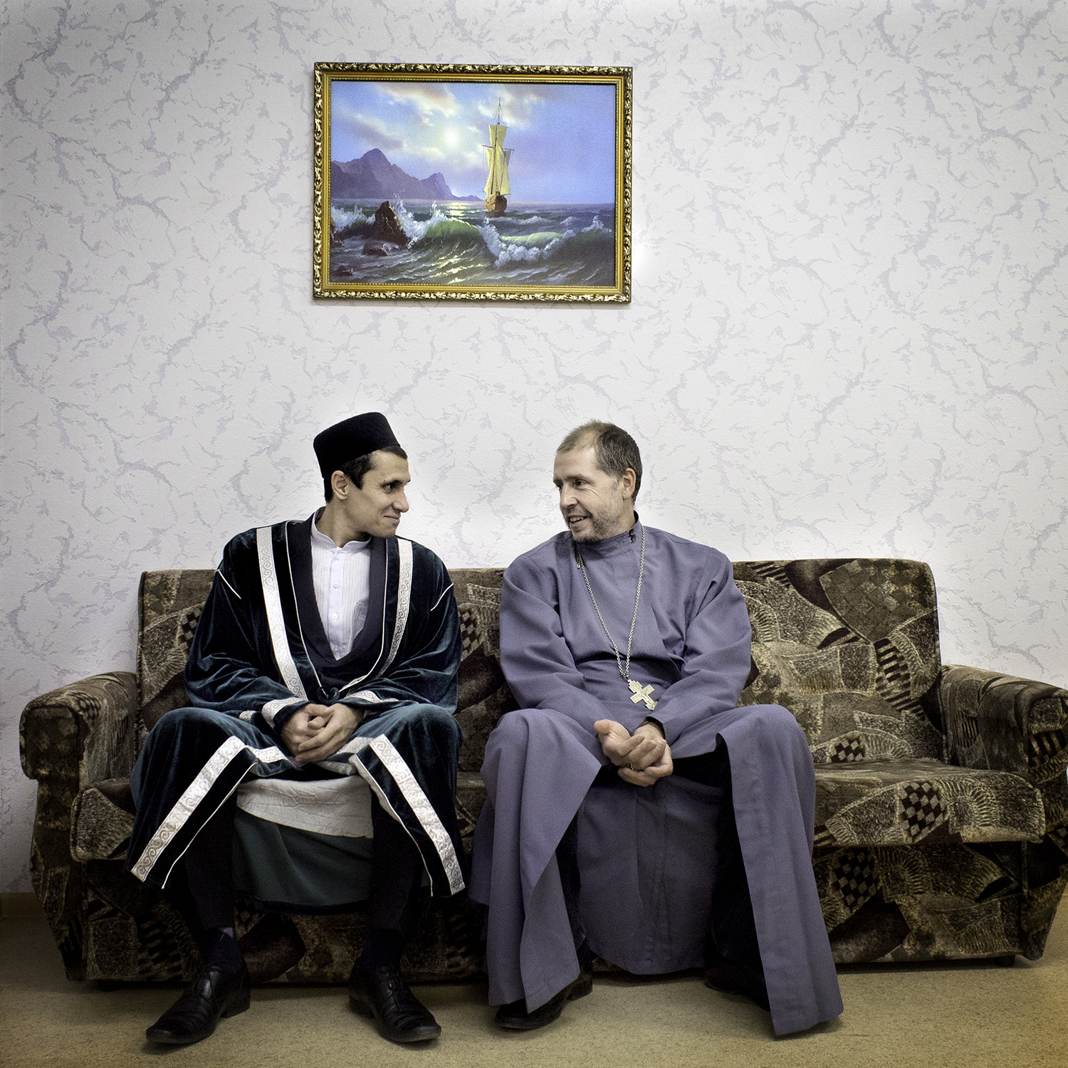 Orthdox Christian priest father Feodor (right) with a Muslim clergy at a school fete celebrating the Muslim sacrificial festival Kurban Bayram.