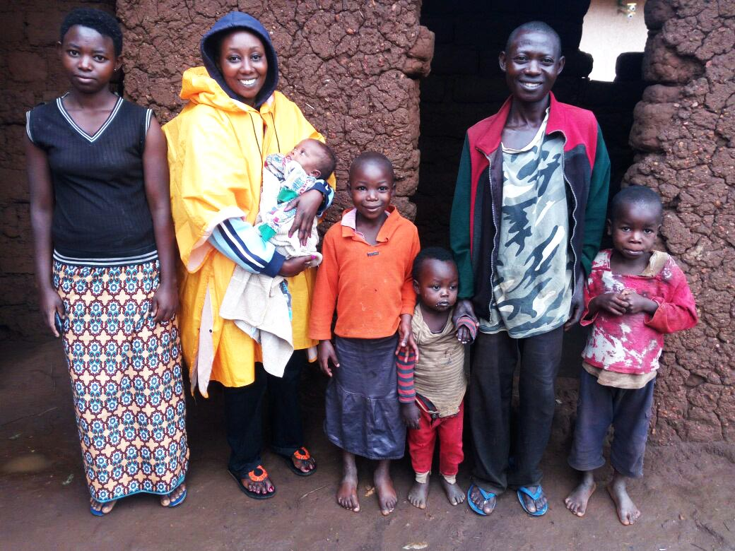 Annonciata, GHI Health Coordinator, with baby Chantal and her Family
