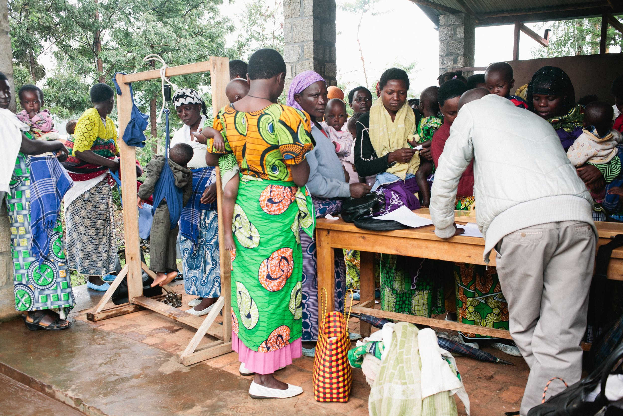 Caregivers attend a growth monitoring campaign