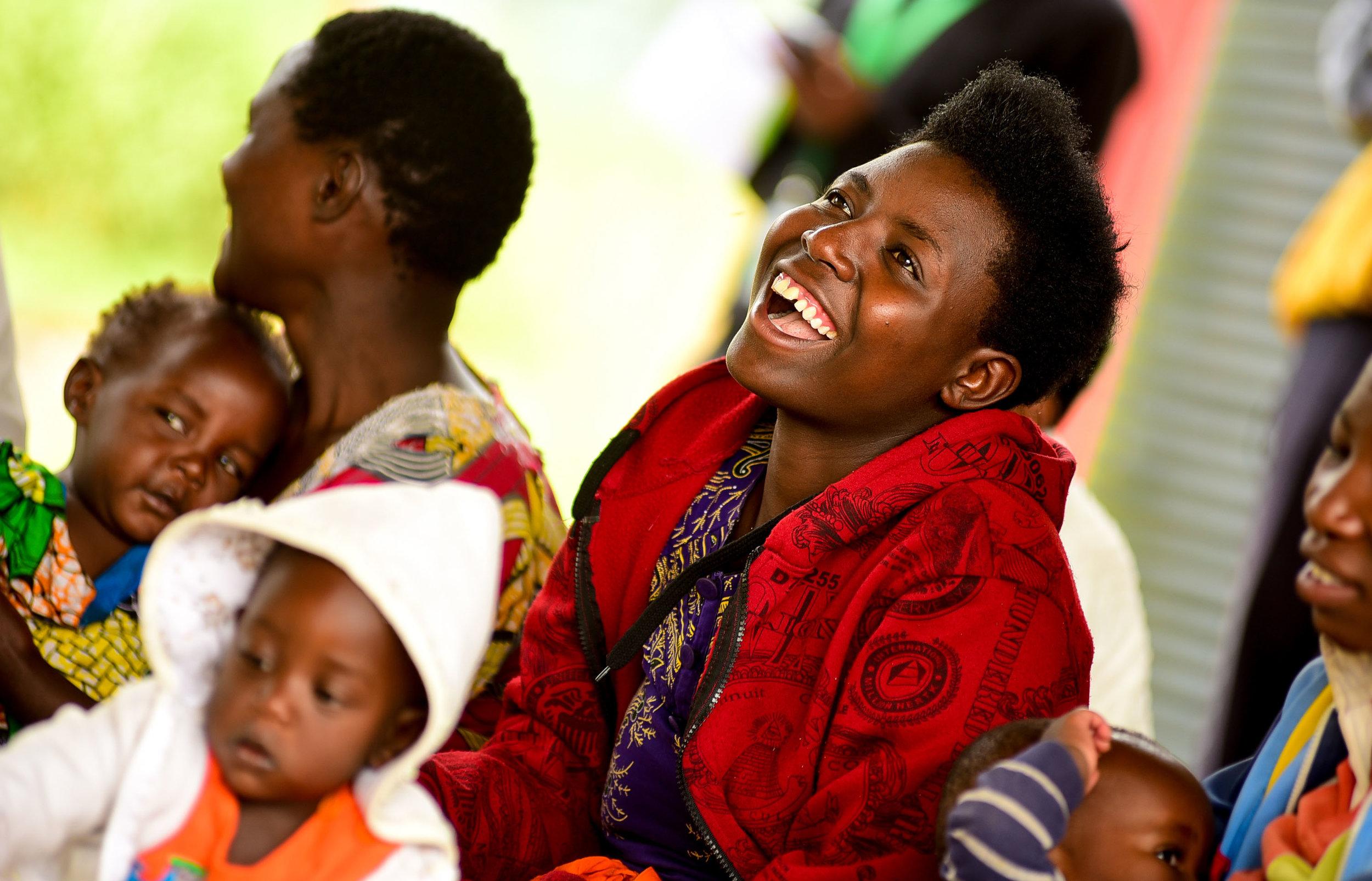 Nyiramariza Lawrence aseka igihe yari yitabiriye amahugurwa ku isuku yabereye ku kigo nderabuzima cya Musanze muri Mutarama 23, 2018.
