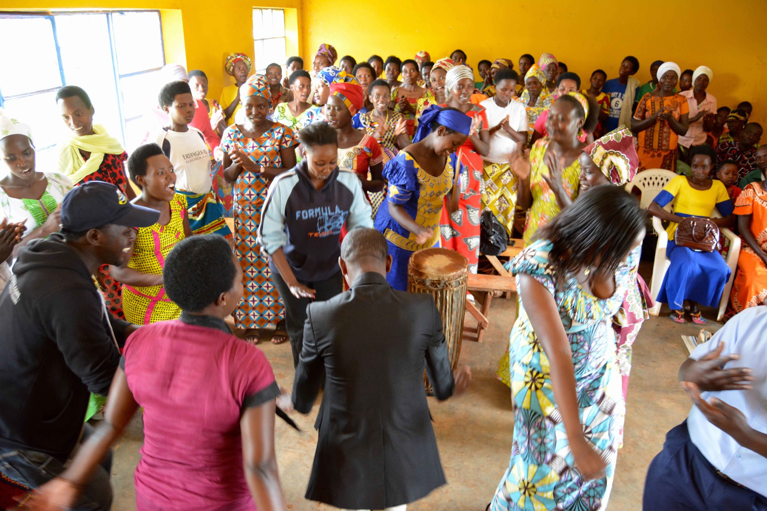 Mothers and field educators celebrate together at the graduation ceremony.