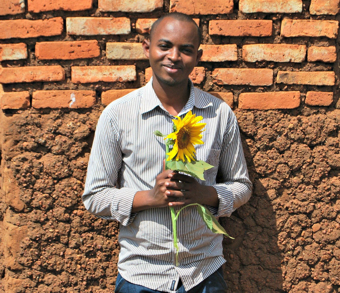 Godfrey, Agricultural Manager with seedlings.