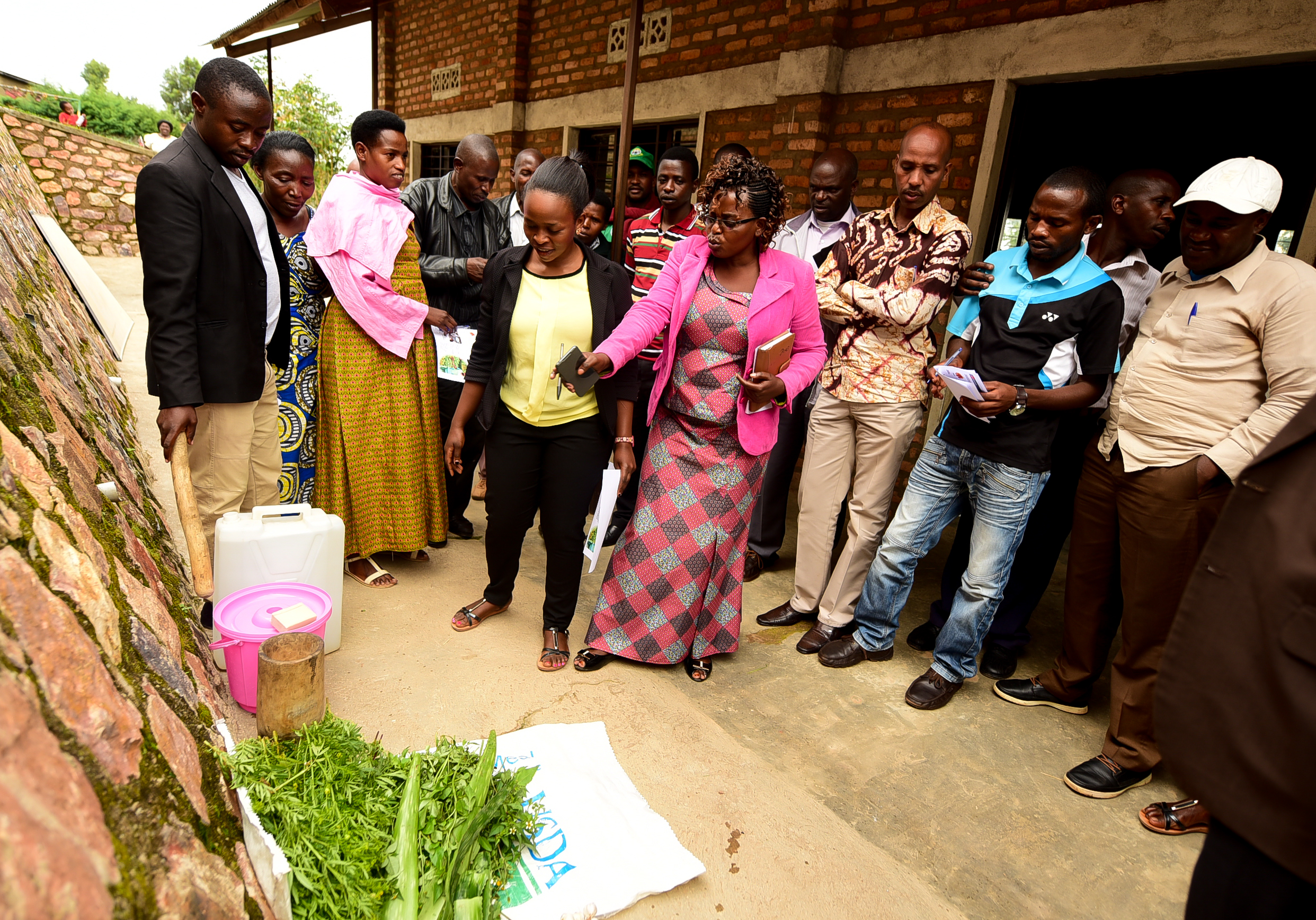 GHI Farm Manager Denyse teaches the steps of making a homemade Pili Pili pesticide.