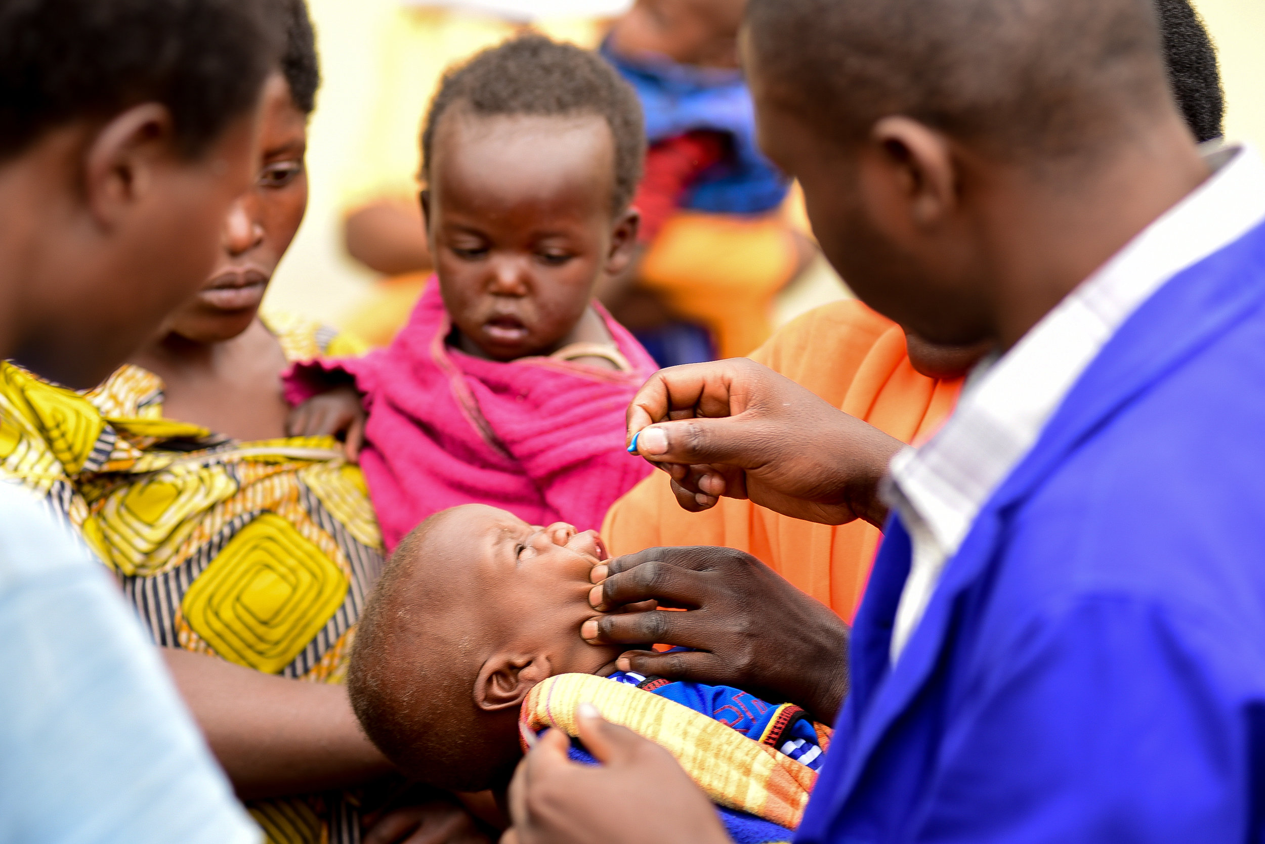 Muhawenimana Kevine is dewormed at her local health center. Malnourished children are at higher risks for certain diseases and parasites, including common intestinal worms found in rural Rwanda.