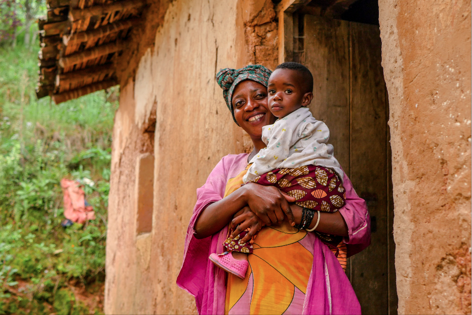 Marie Jeanne and her daughter Quevinne at the entrance of their home in Gashaki, Musanze, Rwanda.