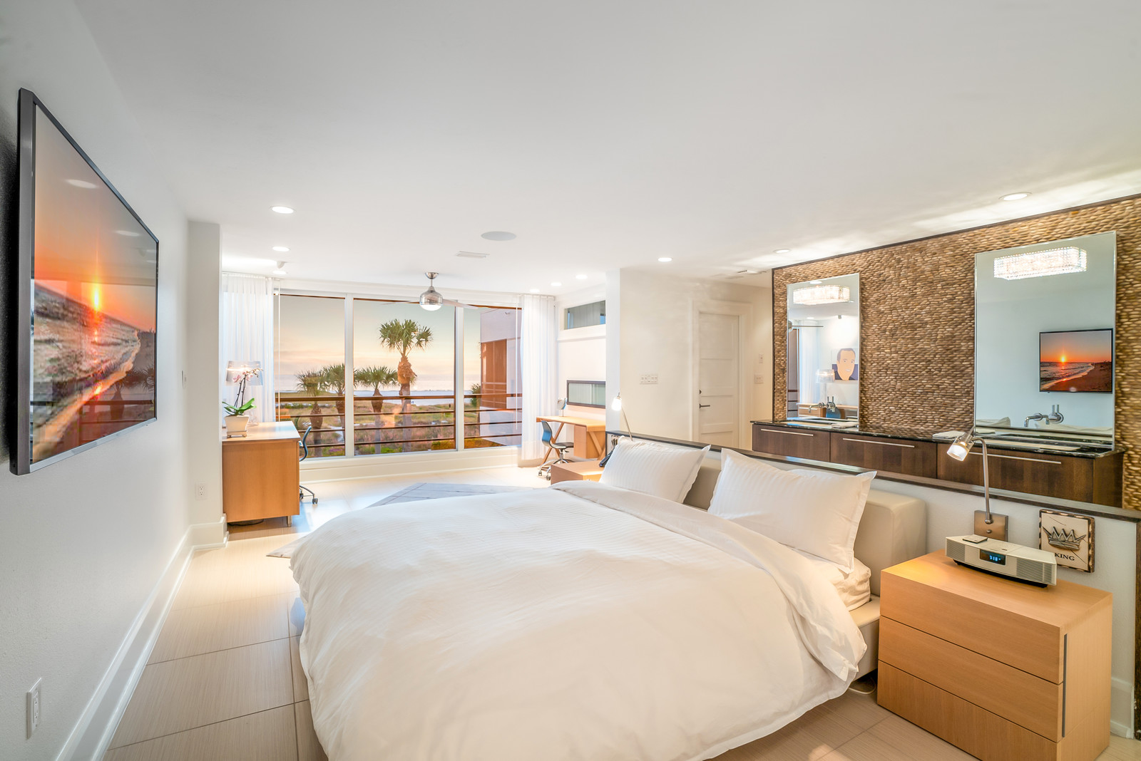 The master suite is a modern oasis that feels like a luxurious, 4-star hotel. Spanning white wall space will host the big-screen or an art collection. Complete with dual walk-in closets and river rock master bath, this suite is dressed to impress.