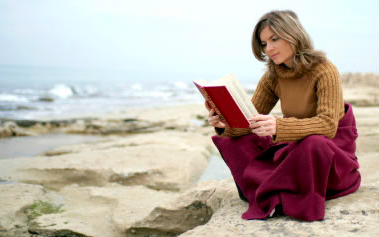It is never too cold for a book & a blanket on the beach.