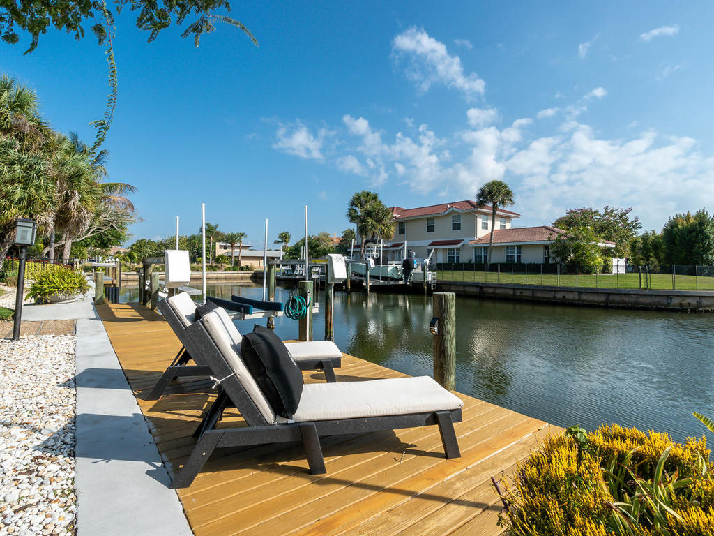 Completely renovated in recent years, including seawall and sunning desk.