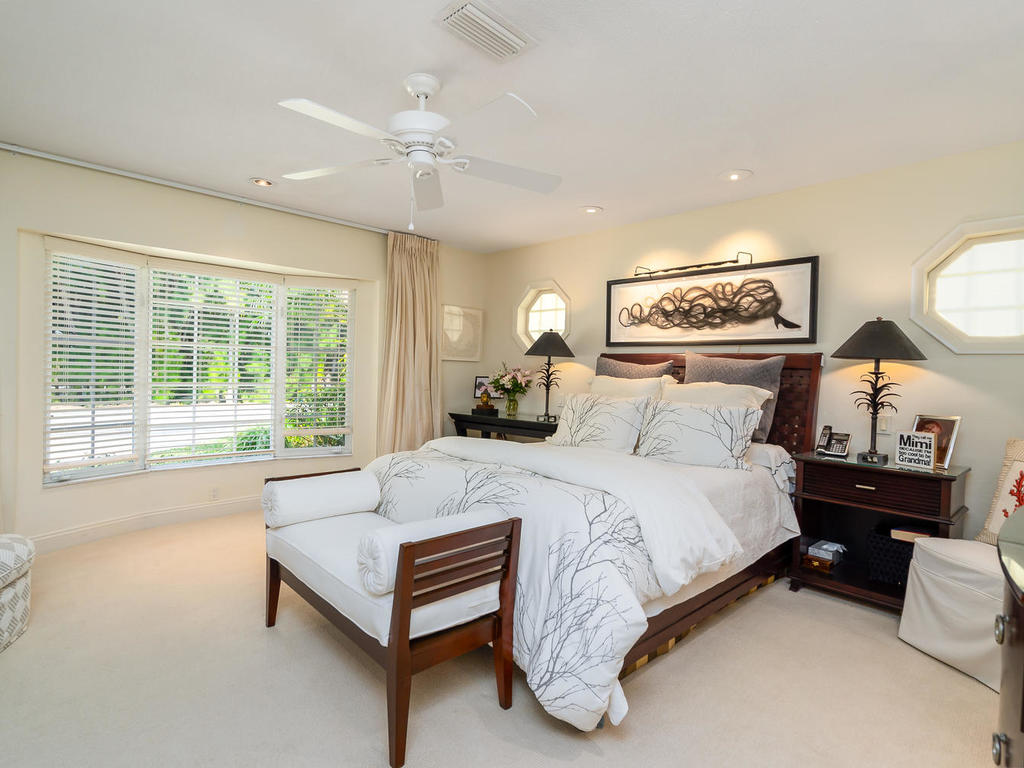 A peaceful master suite is bright thanks to large bay window and features a beautiful tone-on-tone ensuite bath as well as a customized walk-in closet with motion-detected lighting.