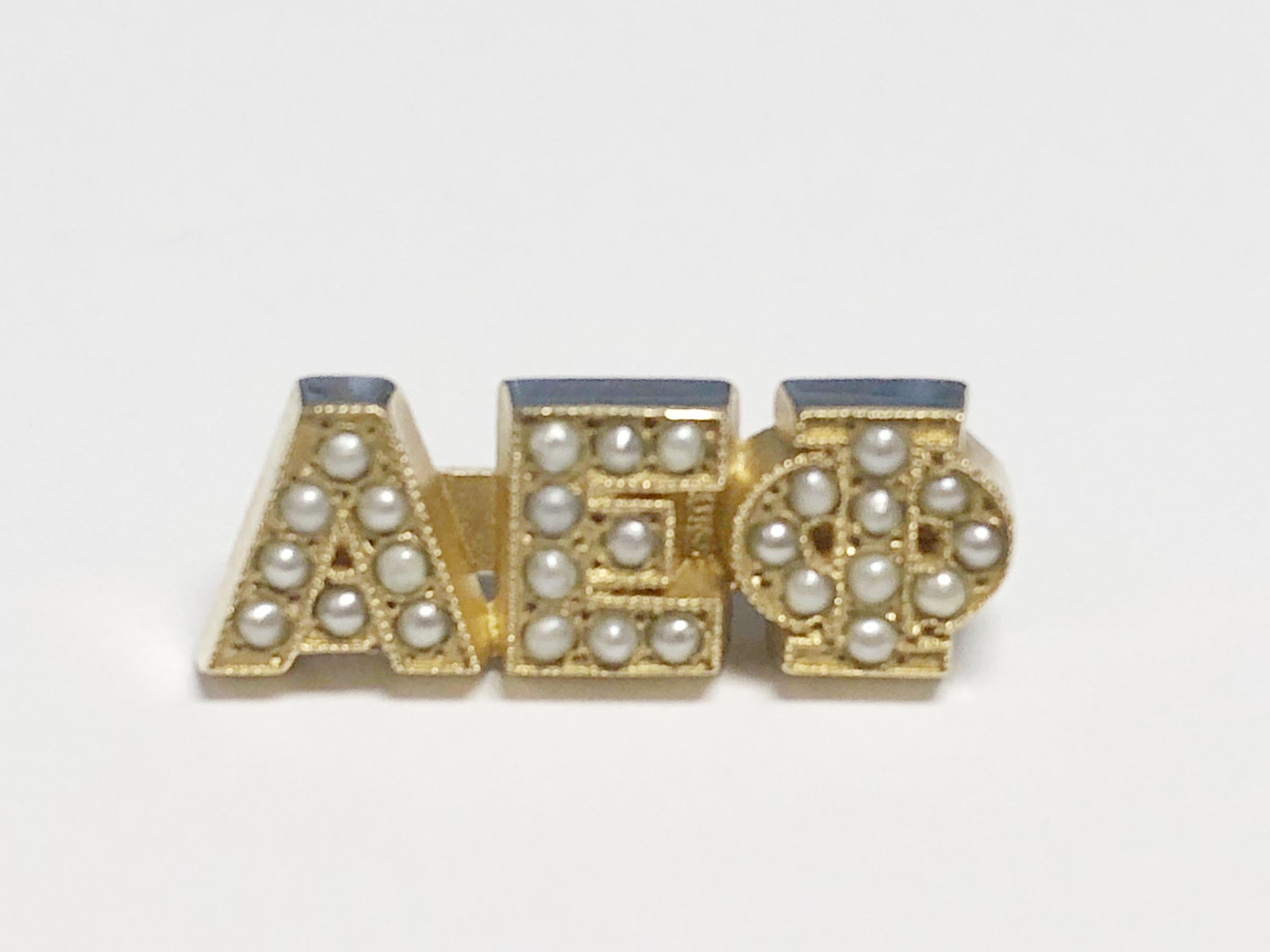 BADGE - Α, Ε & Φ upon a thin gold bar with a total of 27 pearls.  Α has 8 pearls Ε has 9 pearls Φ has 10 pearls
