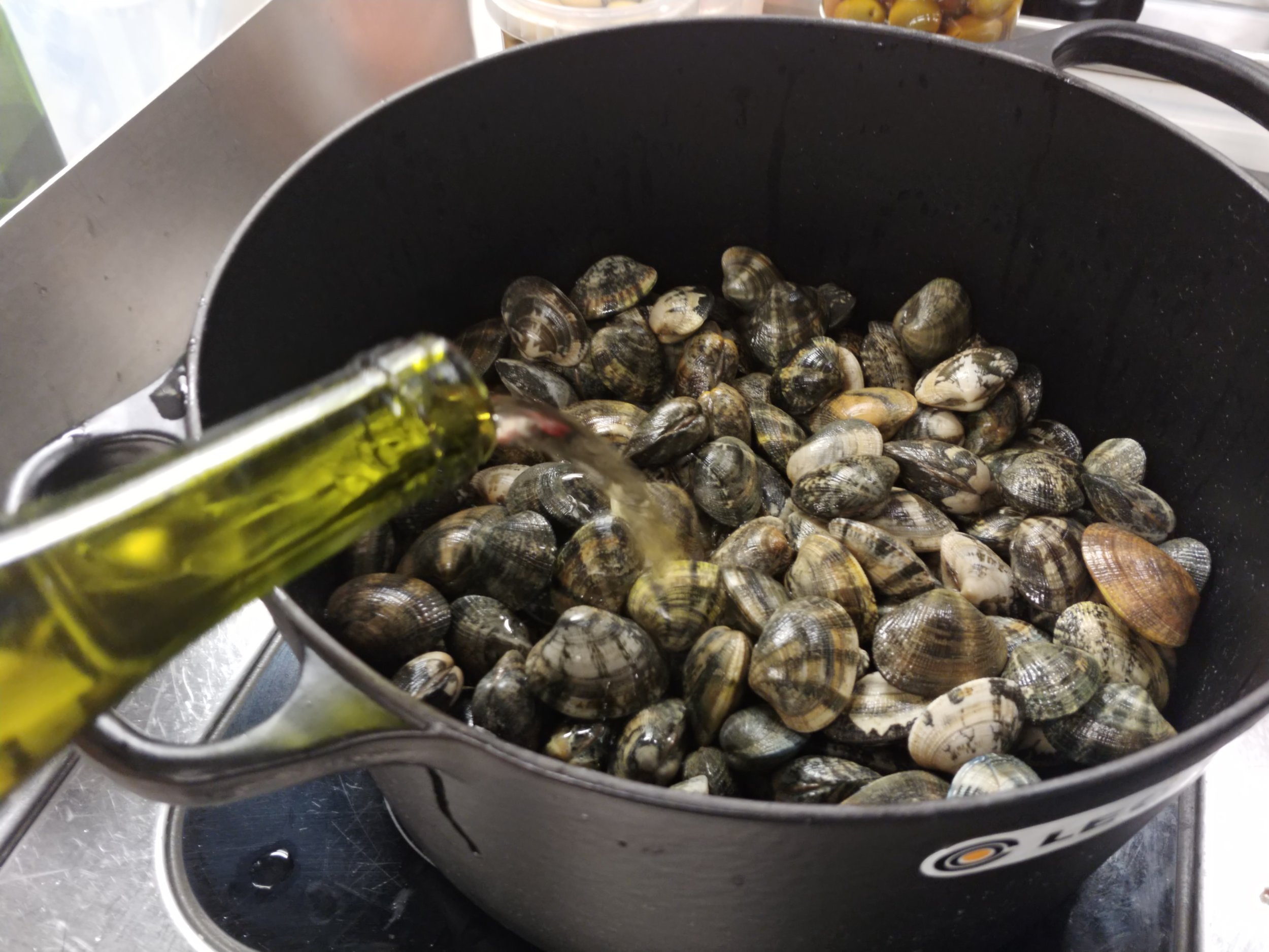 Steam - The clams with the wine in a separate pan on a high heat with the lid on for 5 minutes.