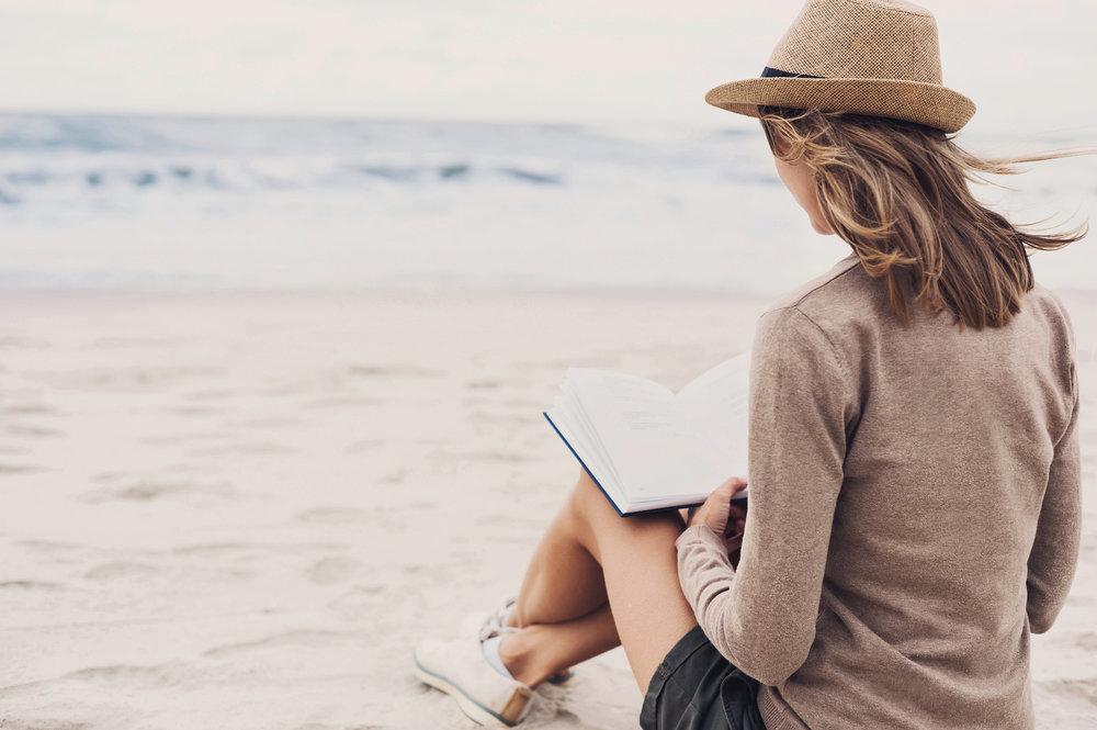 Self+motivated+woman+sitting+on+beach+setting+goals.jpeg
