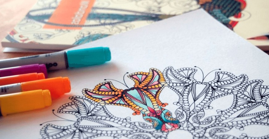 colouring mandala with markers.jpeg