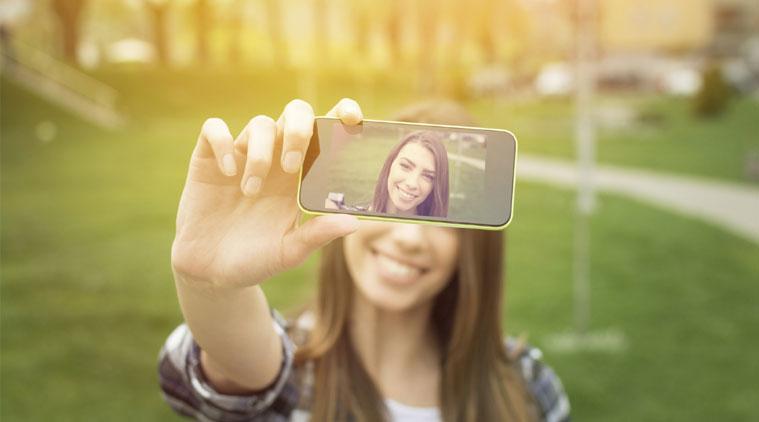 woman taking a selfie on smartphone.jpeg