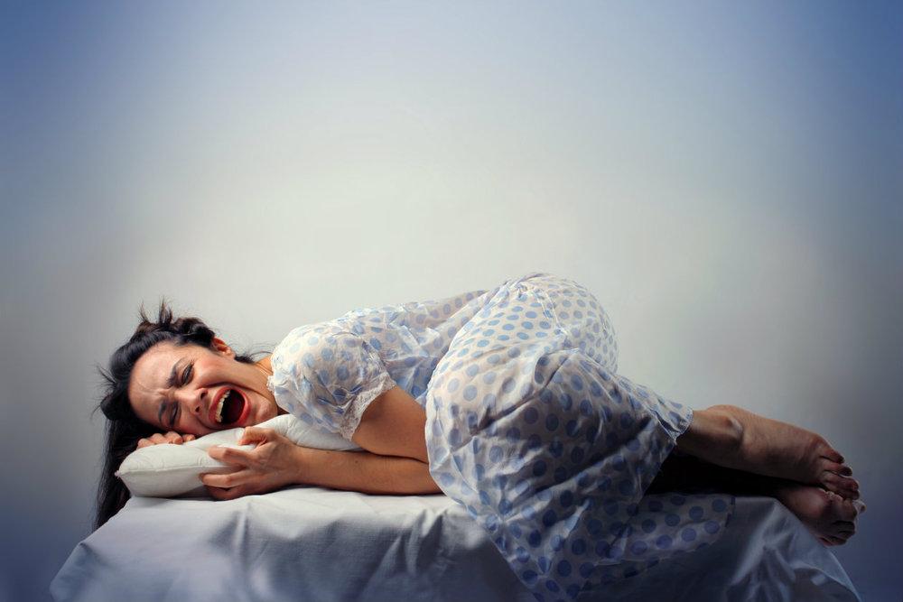 woman having nightmare asleep.jpeg
