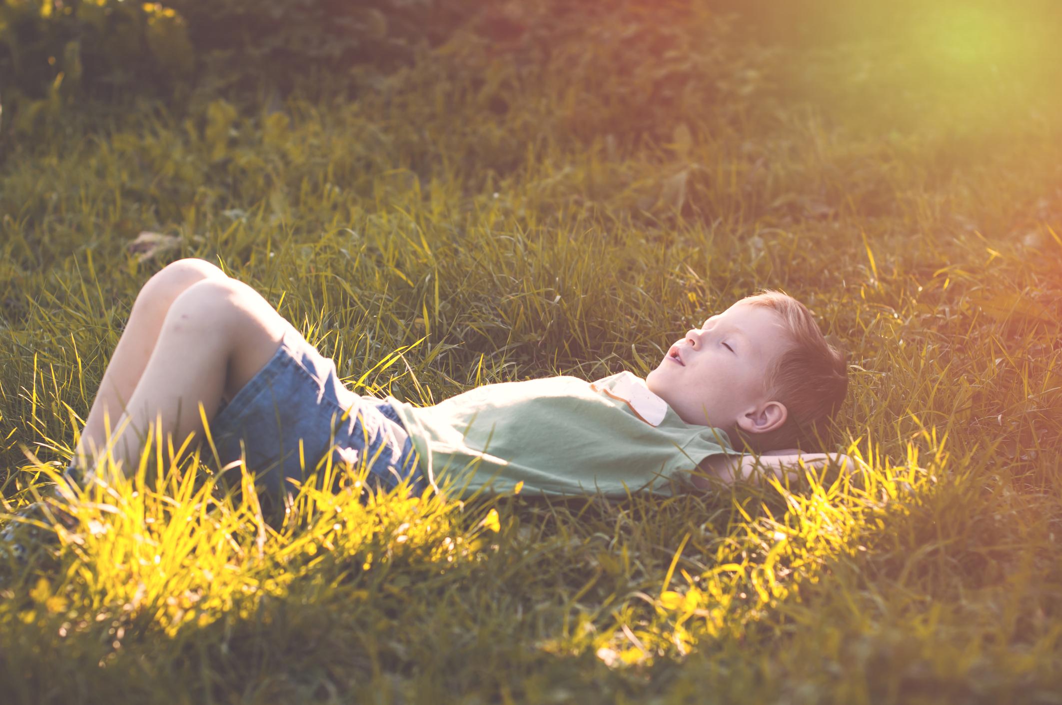 Child peacefully sleeps on nature - kid.jpg